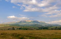 Village in the background of the rocky mountains Stock Image