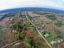 Village in the backwoods of Russia. The view from the top. The village of Popovka, one street Stock Photos
