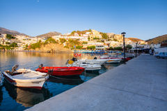 Village Bali, Island Crete, Greece, - June 24, 2016: Beautiful morning scenery with mountains, bay of Mediterranean sea and a pier Stock Images
