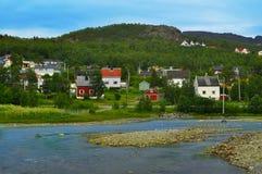 Village on banks of mountain stream. Royalty Free Stock Photos