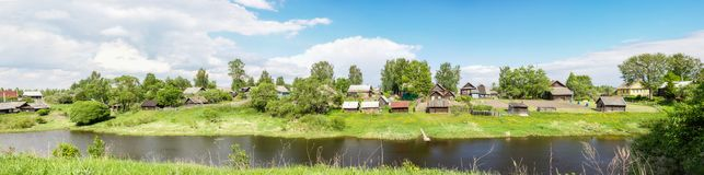 Village on the banks river Stock Photography