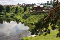 Village on the banks of the river Chusovaya. Cottages on the river Chusovaya in the Perm region Stock Images