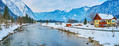 The village on banks of Traun river, Obertraun, Salzkammergut, Austria. The snowbound valley among the great Alps of Dachstein mountain range with Obertraun royalty free stock image