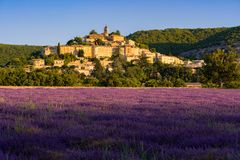 The village of Banon in Provence with lavender fields at sunrise in summer. Alpes-de-Hautes-Provence. Alps, France. The village of Banon in Provence with royalty free stock image