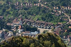 Village at the base of a cliff. The houses around the church aligned. Rametea, Romania Royalty Free Stock Photos