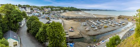 The village, bay and harbour of Saundersfoot, Wales. At low tide in summer, viewed from St Brides hill royalty free stock photography