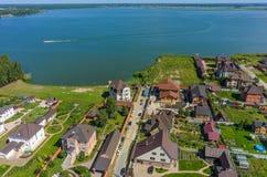 Village with beach on bank of lake. Borovskiy Royalty Free Stock Image