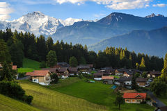 Village at Beatenberg. With Jungfraujoch in background Stock Photos