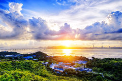 Village with beautiful sunset over hong kong  coastline. Stock Photo