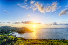 Village with beautiful sunset over hong kong coastline Stock Photo