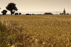 Village behind the field. In the Czechia stock photography