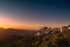 Village of Belgodere in Corsica lit by dramatic sunset. Ancient hilltop village of Belgodere in the Balagne region of Corsica lit up by a dramatic evening sunset Stock Photography