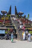 Village of Besakih, Bali/Indonesia - circa October 2015: People are going to praying in Pura Besakih temple royalty free stock image