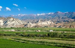 Village in bizarre scenic Tien Shan mountains Stock Photos