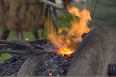 Free Village Blacksmith Near Bellows And Anvil At Work Stock Photography - 107450282