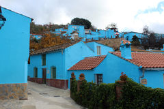 Village with blue houses Stock Photos