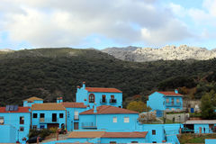 Village with blue houses Stock Images