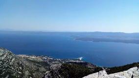 Village Bol and Zlatni Rat Beach on Brac Island viewed from Mountain Vidova Gora, Croatia stock images