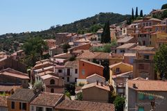 The village of Bormes-les-Mimosas on the Cote d'Azur. The medieval village of Bormes-les-Mimosas on the Cote d'Azur in the Provence region of France stock images
