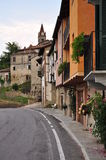 Village of Bossolasco, Langhe, South Piemonte, Italy. Bossolasco central street: typical Northern Italian village in the southern part of Piemonte. City road stock photography