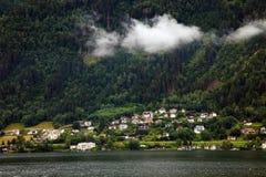 Village at the bottom of the mountain Stock Photos