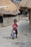 Village Boy. A little poor boy looking at camera in an Indian village Royalty Free Stock Images