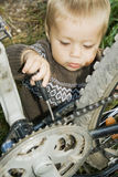 Village Boy Repaired A Bicycle. Royalty Free Stock Image