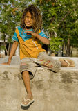 A village boy sitting on a small wall Royalty Free Stock Photography