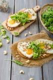 Village bread, fried eggs Stock Photos
