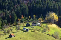 Village in Bucegi mountains. Aerial view of village in Bucegi mountains with green forest and fields, Romania stock image