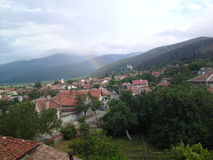 Village. In Bulgaria at the foot of Stara Planina gentle rainbow clouds and rest Royalty Free Stock Photo