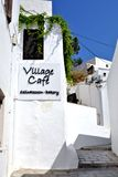 Village cafe. In Rhodes Island. Lindos village. Beautiful white house and incredible blue sky stock images