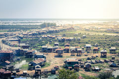 Village in cambodia landscape - houses on piles Stock Photos