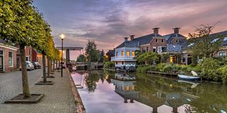 Village canal scene onderdendam. Village canal scene with bridge in town of Onderdendam Groningen Province Netherlands royalty free stock photography