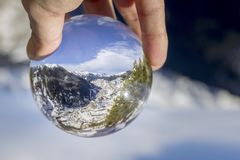 Village of Canillo reflection view through crystal ball, in Roc Del Quer. Andorra. Village of Canillo reflection view through crystal ball, in Roc Del Quer Royalty Free Stock Images