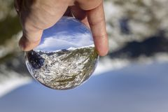 Village of Canillo reflection view through crystal ball, in Roc Del Quer. Andorra. Village of Canillo reflection view through crystal ball, in Roc Del Quer Stock Photo