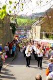 Village carnival parade. The brass band leading the Village carnival parade at Ashover, Derbyshire, England, UK Stock Photos