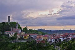 A view of Castellino Tanaro, with its ancient tower, in the Langhe, Piedmont, Italy. Royalty Free Stock Photo