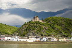 Village and castle on Rhine Valley. A castle overlooking the valley of the Rhine stock photography