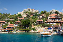 Village with castle at the sea Stock Photography