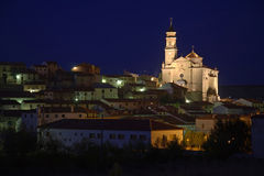 Village with cathedral by night Stock Image