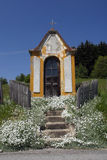 Village chapel. In summer countryside against blue sky, Pohorje, Slovenia Royalty Free Stock Photo