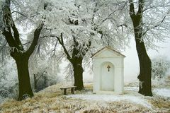 Village chapel in winter01 Royalty Free Stock Photos