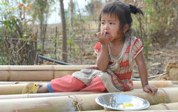 Hungry Village child eating Meal stock image