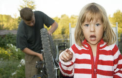 Village children repaired a bicycle. Royalty Free Stock Photography