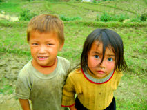 Village children of Sapa Vietnam. Two young children playing in the rice fields in Sapa Vietnam Royalty Free Stock Photography
