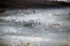 Village chimneys fog Royalty Free Stock Image