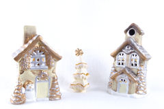 Village christmas on the snow. Two ceramic houses around christmas tree Royalty Free Stock Photography