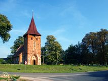 Village church. Small village church at a crossroads, Poland Royalty Free Stock Photos