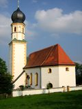 Village church. Small church located in a Bavarian village, with blue sky clouded background Stock Photos